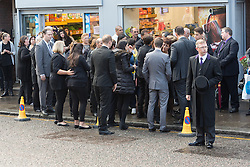 © Licensed to London News Pictures. 24/09/2014. Edmonton, UK. Friends and family meet and the funeral cortege of Palmira Silva, an 82 year old grandmother who was killed by a machete in her back garden passes Sliva's Cafe in Church Street, Edmonton on 24th September 2014, where family. Photo credit : Vickie Flores/LNP