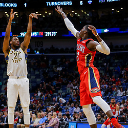 Mar 21, 2018; New Orleans, LA, USA; Indiana Pacers forward Thaddeus Young (21) shoots over New Orleans Pelicans forward Cheick Diallo (13) during the second quarter at the Smoothie King Center. Mandatory Credit: Derick E. Hingle-USA TODAY Sports