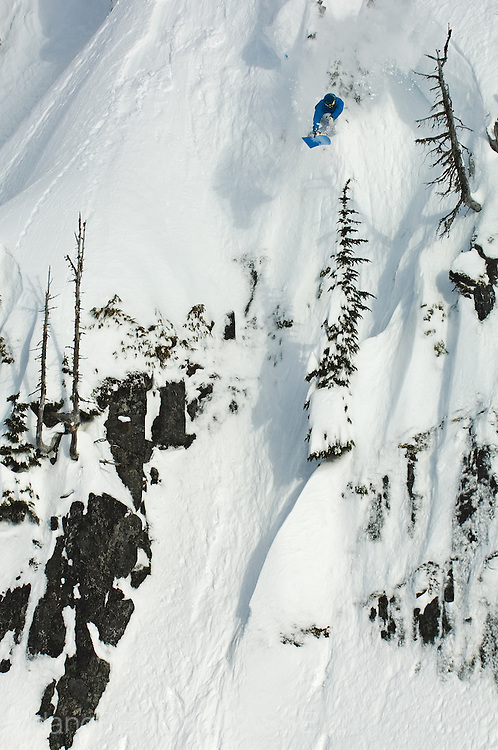 Professional snowboarder Shin Campos launches through the air in the backcountry near Whistler, British Columbia, Canada.
