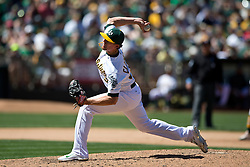 OAKLAND, CA - JUNE 21:  Tyler Clippard #36 of the Oakland Athletics pitches against the Los Angeles Angels of Anaheim during the eighth inning at O.co Coliseum on June 21, 2015 in Oakland, California. The Oakland Athletics defeated the Los Angeles Angels of Anaheim 3-2. (Photo by Jason O. Watson/Getty Images) *** Local Caption *** Tyler Clippard