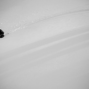 Tyler Hatcher pulls his skins for another run in the Cascade backcountry during a winter storm.