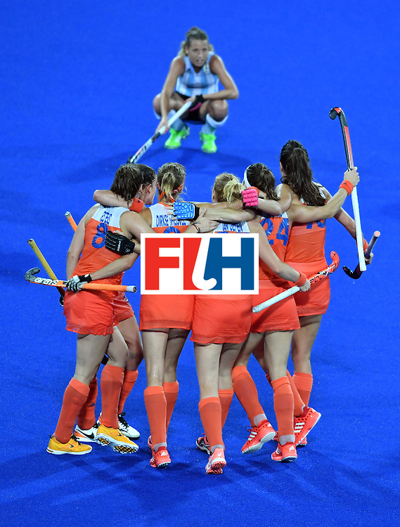 Netherland's players celebrate after winning the women's quarterfinal field hockey Netherland vs Argentina match of the Rio 2016 Olympics Games at the Olympic Hockey Centre in Rio de Janeiro on August 15, 2016.  / AFP / Pascal GUYOT        (Photo credit should read PASCAL GUYOT/AFP/Getty Images)