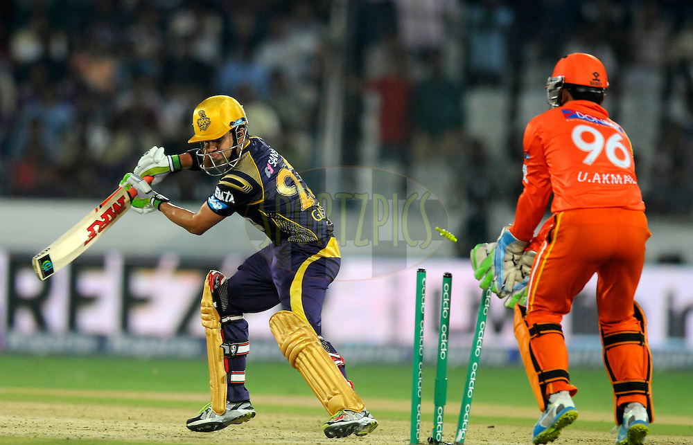 Gautam Gambhir captain of Kolkata Knight Riders gets bowled out by Mustafa Iqbal of Lahore Lions during match 7 of the Oppo Champions League Twenty20 between the Kolkata Knight Riders and the Lahore Lions held at the Rajiv Gandhi Cricket Stadium, Hyderabad, India on the 21st September 2014<br /> <br /> Photo by:  Pal Pillai / Sportzpics/ CLT20<br /> <br /> <br /> Image use is subject to the terms and conditions as laid out by the BCCI/ CLT20.  The terms and conditions can be downloaded here:<br /> <br /> http://sportzpics.photoshelter.com/gallery/CLT20-Image-Terms-and-Conditions-2014/G0000IfNJn535VPU/C0000QhhKadWcjYs