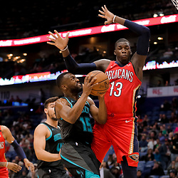 Apr 3, 2019; New Orleans, LA, USA;  Charlotte Hornets guard Kemba Walker (15) shoots over New Orleans Pelicans forward Cheick Diallo (13) during the first quarter at the Smoothie King Center. Mandatory Credit: Derick E. Hingle-USA TODAY Sports