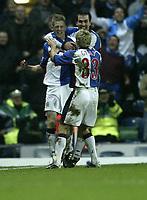 Fotball<br /> Premier League 2003/2004<br /> Photo. Aidan Ellis.<br /> Blackburn Rovers v Newcastle United.<br /> FA Barclaycard Premiership.<br /> 11/02/2004.<br /> Blackburn's Johnathon Stead celebrates his equaliser with team mates Michael Gray and Marcus Babbell