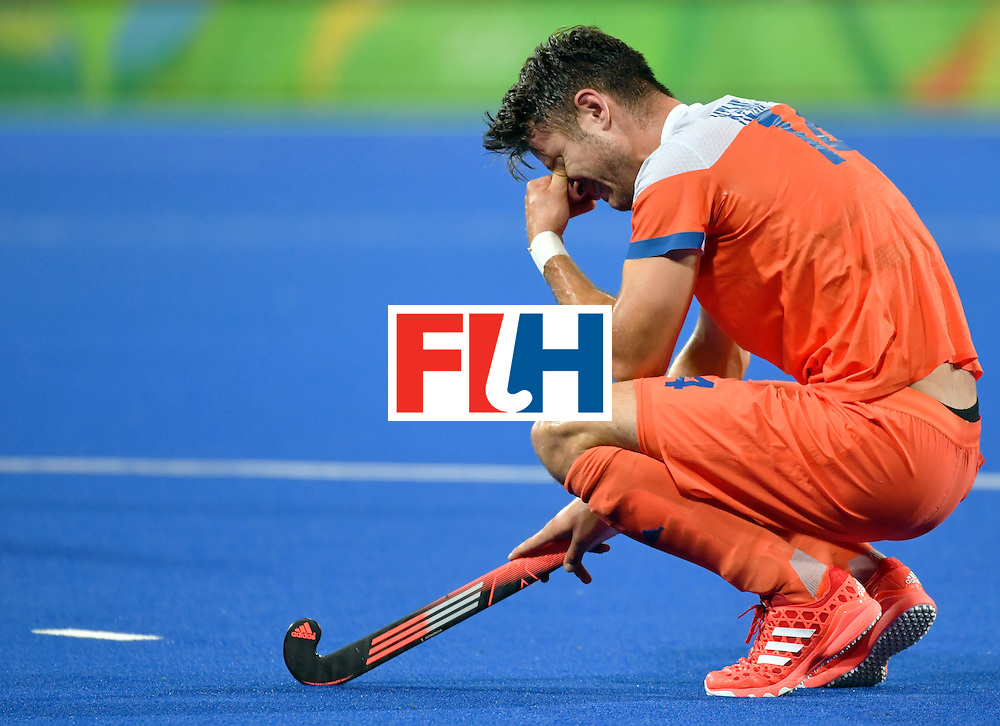 Netherland's Robbert Kemperman cries after missing the men's semifinal field hockey Belgium vs Netherlands match of the Rio 2016 Olympics Games at the Olympic Hockey Centre in Rio de Janeiro on August 16, 2016.  / AFP / Pascal GUYOT        (Photo credit should read PASCAL GUYOT/AFP/Getty Images)