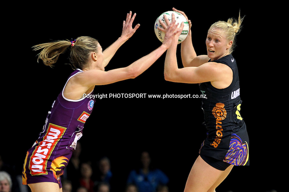Magic's Laura Langman competes against Firebirds' Amy Steel. ANZ Netball Championship, Waikato/Bay of Plenty Magic v Queensland Firebirds, Claudelands Arena, Hamilton, New Zealand. Monday 2nd July 2012. Photo: Anthony Au-Yeung / photosport.co.nz