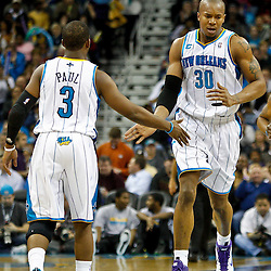 January 24,  2011; New Orleans, LA, USA; New Orleans Hornets power forward David West (30) celebrates with point guard Chris Paul (3) after scoring against the Oklahoma City Thunder during the third quarter at the New Orleans Arena. The Hornets defeated the Thunder 91-89. Mandatory Credit: Derick E. Hingle