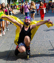 A man on rollerblades makes his way along the procession route as day one, Children's Day, of the Notting Hill Carnival gets underway in London. London, August 25 2019.
