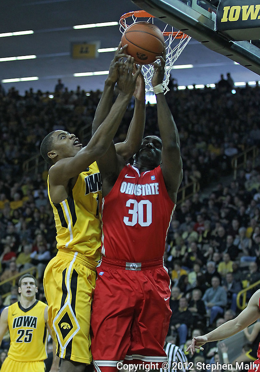 January 07, 2011: Iowa Hawkeyes forward Melsahn Basabe (1) and Ohio State Buckeyes forward Evan Ravenel (30) battle for a rebound during the the NCAA basketball game between the Ohio State Buckeyes and the Iowa Hawkeyes at Carver-Hawkeye Arena in Iowa City, Iowa on Saturday, January 7, 2012.