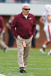 Nov 26, 2011; Charlottesville VA, USA;  Virginia Tech Hokies head coach Frank Beamer watches his team warm up before the game against the Virginia Cavaliers at Scott Stadium.  Virginia Tech defeated Virginia 38-0. Mandatory Credit: Jason O. Watson-US PRESSWIRE