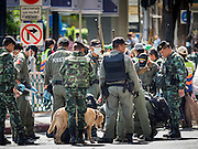 18 AUGUST 2015 - BANGKOK, THAILAND: Thai police and EOD teams at Erawan Shrine Tuesday. An explosion at Erawan Shrine, a popular tourist attraction and important religious shrine in the heart of the Bangkok shopping district killed at least 20 people and injured more than 120 others, including foreign tourists, during the Monday evening rush hour. Twelve of the dead were killed at the scene. Thai police said an Improvised Explosive Device (IED) was detonated at 18.55. Police said the bomb was made of more than six pounds of explosives stuffed in a pipe and wrapped with white cloth. Its destructive radius was estimated at 100 meters.    PHOTO BY JACK KURTZ