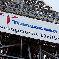 Signage for Transocean on the derek of the Transocean Development Driller II rig leased by BP Plc which is drilling a backup relief well at the BP Plc Macondo well site in the Gulf of Mexico off the coast of Louisiana, U.S., on Saturday, August 7, 2010. BP successfully used the 'static kill', procedure  pumping mud into the top of the damaged well, BP plans now to finish a relief well to permanently plug the well by mid-August. Photographer: Derick E. Hingle/Bloomberg