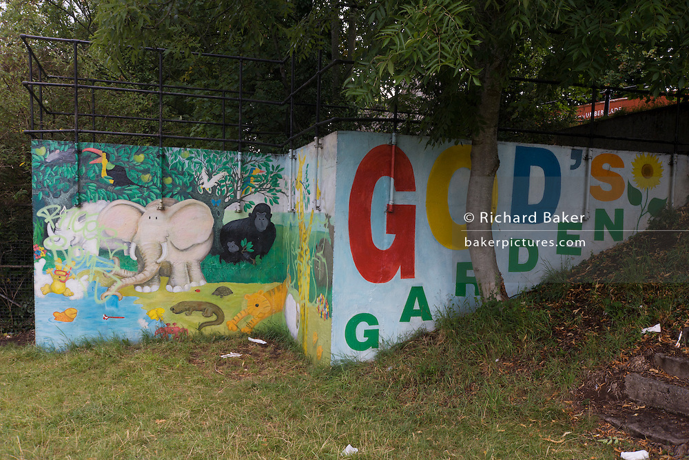 A mural depicting God's garden of Eden on wasteland alongside the river Avon in central Bristol.