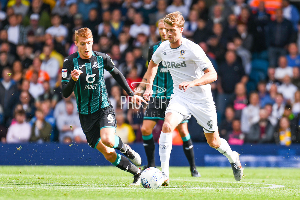 Leeds United forward Patrick Bamford (9) and Swansea City midfielder Jay Fulton (6) during the EFL Sky Bet Championship match between Leeds United and Swansea City at Elland Road, Leeds, England on 31 August 2019.