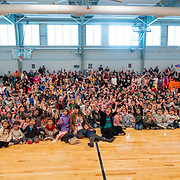 Students and teachers pose for a photo during a ribbon cutting ceremony in the new gymnasium at Eastwood Elementary School in Hillsboro, Ore., on Tuesday, Feb. 4, 2020.