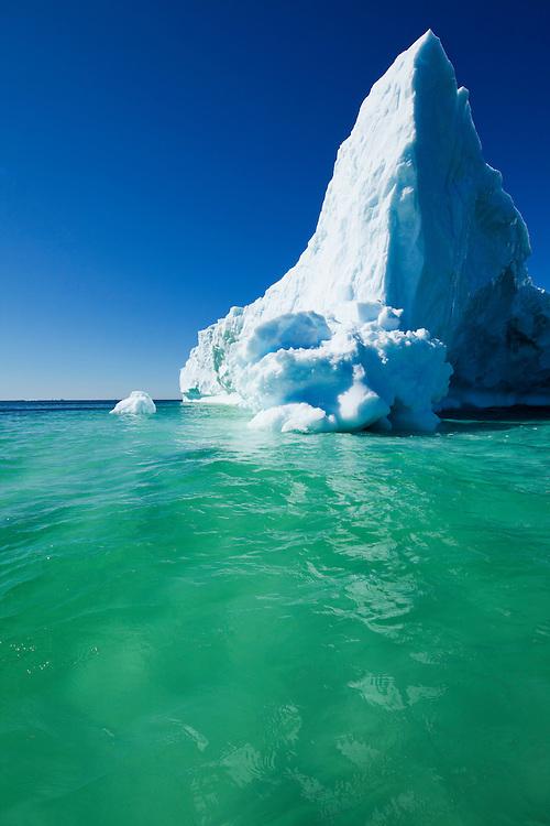 Greenland, Ilulissat, Massive iceberg floating near face of Eqip Glacier along Disko Bay on summer day
