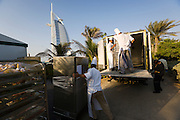 Jumeirah, Burj Al Arab, the World's most luxurious hotel. Preparation of a festive dinner buffet on Jumeirah Beach.