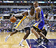 Feb. 28, 2012; Indianapolis, IN, USA; Indiana Pacers center Roy Hibbert (55) drives the ball against Golden State Warriors center Andris Biedrins (15) at Bankers Life Fieldhouse. Mandatory credit: Michael Hickey-US PRESSWIRE