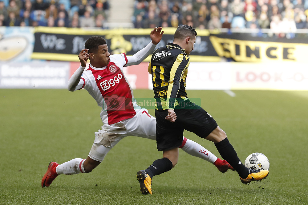 (L-R) David Neres of Ajax, Bryan Linssen of Vitesse during the Dutch Eredivisie match between Vitesse Arnhem and Ajax Amsterdam at Gelredome on March 04, 2018 in Arnhem, The Netherlands