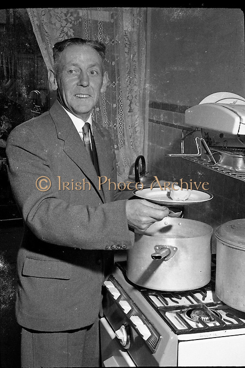 Maguire family celebrates the arrival of their 20th baby at the Rotunda Hospital. Even for its time, this was an unusually large family, and the event made the British as well as the Irish papers..Mr. Maguire cooks..09.10.1960