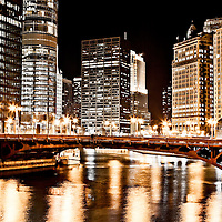 Chicago at night at State Street Bridge (Bataan-Corregidor Memorial Bridge) along the Chicago River with AMA Building (330 North Wabash formerly IBM Building), Trump International Hotel and Tower (401 North Wabash Avenue), Equitable Building (401 North Michigan Avenue),  London Guarantee Building / Crain Communications Building (360 North Michigan) Mather Tower (75 East Wacker Drive), and Hotel 71 (71 East Wacker Drive).