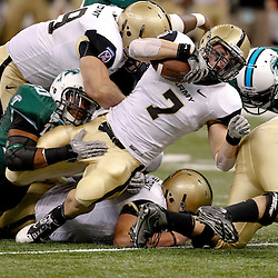 October 9, 2010; New Orleans, LA, USA;  Army Black Knights fullback Jared Hassin (7) is tackled by Tulane Green Wave linebacker Trent Mackey (20) during the first half at the Louisiana Superdome.  Mandatory Credit: Derick E. Hingle