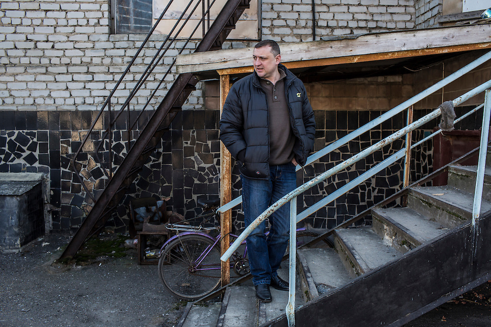 MARIINKA, UKRAINE - FEBRUARY 20, 2016:  Pastor Sergei Kosyak stands outside the Christian Help Center of the Church of the Transfiguration in Mariinka, Ukraine. The Donetsk suburb has been the scene of some of the heaviest fighting recently between Ukrainian forces and pro-Russian rebels. CREDIT: Brendan Hoffman for The New York Times