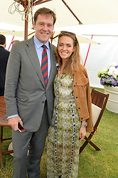 The MARQUESS OF BOWMONT & CESSFORD and ANUSCHKA SENGE at the Cartier Queen's Cup Polo final at Guard's Polo Club, Smiths Lawn, Windsor Great Park, Egham, Surrey on 14th June 2015