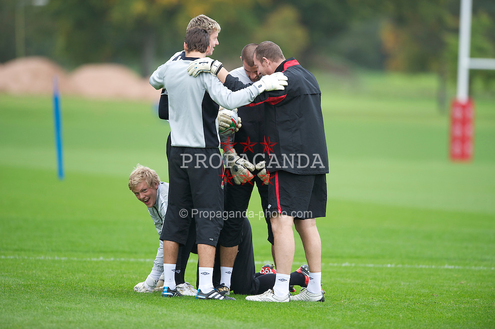 CARDIFF, WALES - Tuesday, October 5, 2010: Wales' goalkeeper David Cornell is forced to crawl as a dog around goalkeeping coach Paul Jones during a training session at the Vale of Glamorgan ahead of the Euro 2012 qualifying Group G match against Bulgaria. (Pic by David Rawcliffe/Propaganda)