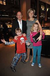 SIMON & SANTA SEBAG-MONTEFIORE with their children LILY and SASHA at a party to celebrate the launch of Simon Sebag-Montefiore's new book - 'Jerusalem: The Biography' held at Asprey, 167 New Bond Street, London on 26th January 2011.