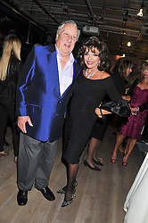 FREDERICK FORSYTH and JOAN COLLINS at a party to celebrate the publication of her  autobiography - The World According to Joan, held at the British Film Institute, South Bank, London SE1 on 8th September 2011.
