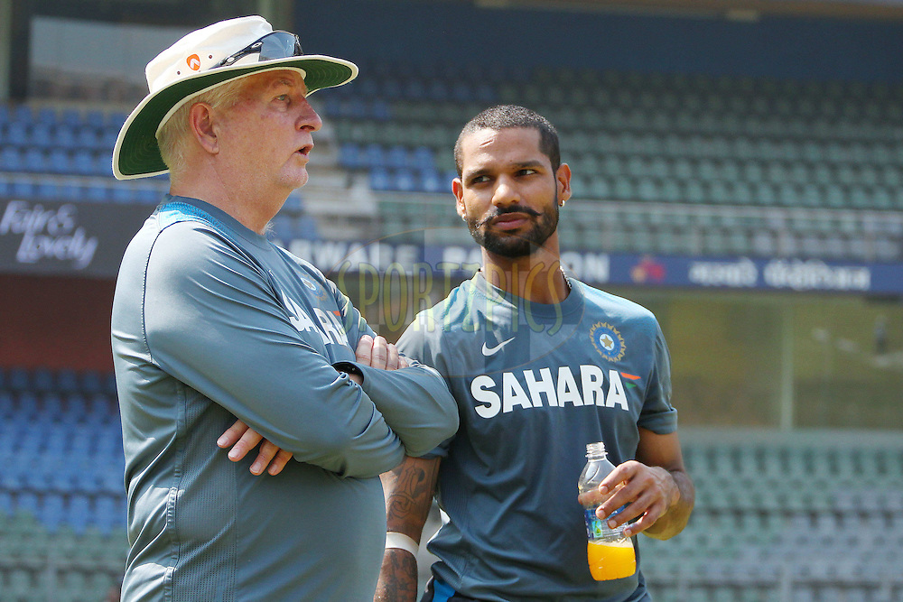 Duncan Fletcher chats with Shikhar Dhawan of India  during the Indian nets session and press conference held at the Wankhede Stadium in Mumbai, India on the 13th November 2013<br /> <br /> Photo by: Ron Gaunt - BCCI - SPORTZPICS