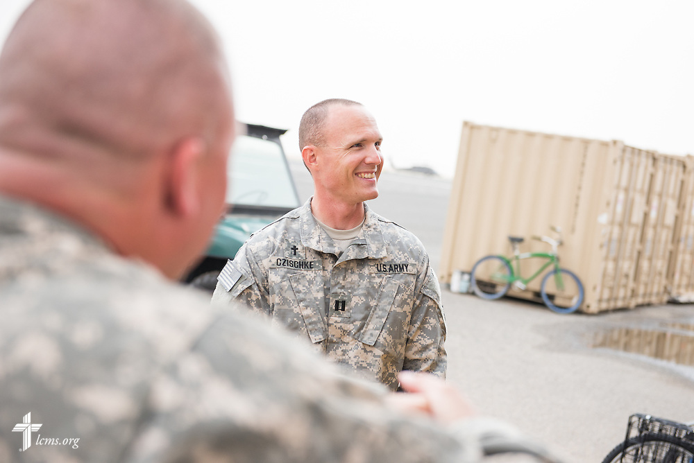 Army Capt. Chad Czischke, chaplain, visits with fellow soldiers on Sunday, March 22, 2015, at Camp Buehring in Kuwait. LCMS Communications/Erik M. Lunsford