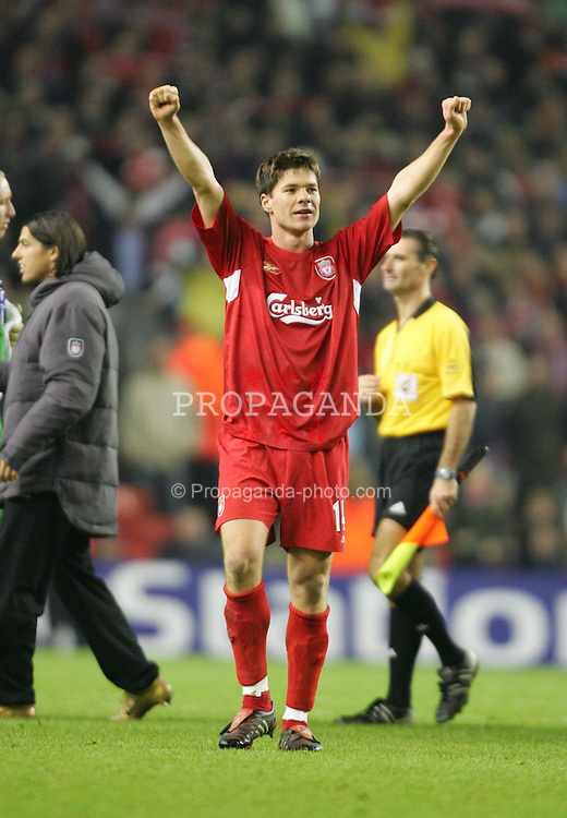 LIVERPOOL, ENGLAND- WEDNESDAY DECEMBER 8th 2004: Liverpool's Xabi Alonso celebrates the 3-1 victory over Olympiakos during the UEFA Champions League Group A match at Anfield. (Pic by David Rawcliffe/Proparganda)