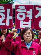 SEOUL, SOUTH KOREA: Members of the South Korean People's Democracy Party, a progressive party, march through central Seoul, in the neighborhood of the US embassy, Tuesday morning to support the summit meeting in Singapore between US President Donald Trump and North Korean leader Kim Jong-un.      PHOTO BY JACK KURTZ