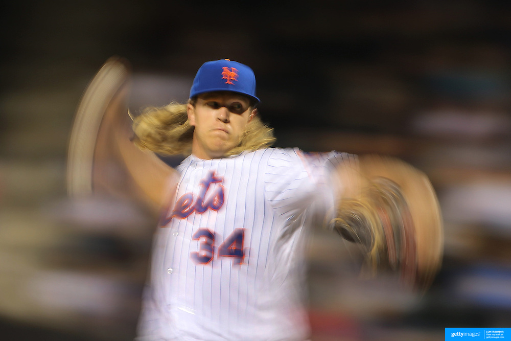 NEW YORK, NEW YORK - APRIL 25: A blur of motion as pitcher Noah Syndergaard #34 of the New York Mets pitching during the New York Mets Vs Cincinnati Reds MLB regular season game at Citi Field on April 25, 2016 in New York City. (Photo by Tim Clayton/Corbis via Getty Images)