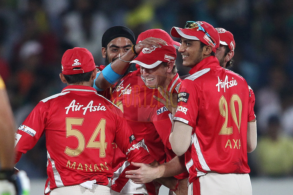 Kings XI Punjab captain George Bailey is congratulated for taking the catch to get Suresh Raina of the Chennai Super Kings wicket during the second semi final match of the Oppo Champions League Twenty20 between the Kings XI Punjab and the Chennai Superkings held at the Rajiv Gandhi Cricket Stadium, Hyderabad, India on the 2nd October 2014<br /> <br /> Photo by:  Shaun Roy / Sportzpics/ CLT20<br /> <br /> <br /> Image use is subject to the terms and conditions as laid out by the BCCI/ CLT20.  The terms and conditions can be downloaded here:<br /> <br /> http://sportzpics.photoshelter.com/gallery/CLT20-Image-Terms-and-Conditions-2014/G0000IfNJn535VPU/C0000QhhKadWcjYs
