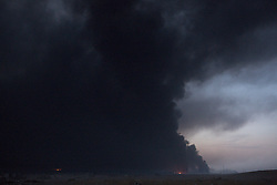 Licensed to London News Pictures. 20/10/2016. Smoke from the burning Qayyarah oilfields blot out the light over the surrounding landscape. The oilfields, which surround the Iraqi town of Qayyarah, were set alight by Islamic State militants as they retreated from Iraqi forces in July 2016.<br /> <br /> Since being retaken from the Islamic State the town of Qayyarah has become an important staging post for the Iraqi Army, and some US support elements, in the buildup to the Mosul offensive. Photo credit: Matt Cetti-Roberts/LNP