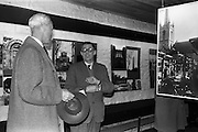 "05/04/1963<br /> 04/05/1963<br /> 05 April 1963<br /> Opening of ""Ulster Today"" architectural photographic exhibition.Organised by the Royal Society of Ulster Architects opened at the Gallery of the Building Centre of Ireland  in Dublin in the presence of Donagh O'Malley, Parlimentary Secretary to the Minister for Finance and Sir Ian MacLennan, British Ambassador to Ireland. The exhibition was later displayed in Belfast. Picture shows: Dr. R.B. McDowell, Trinity College, Dublin, who officially opened the exhibition (right) discussing the exhibition."