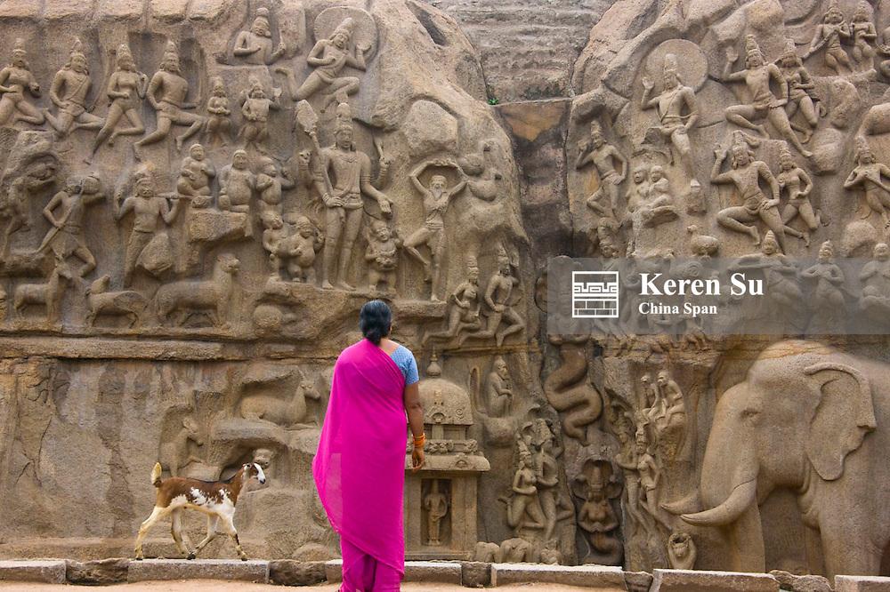 Woman with Arjuna's Penance bas-relief of elephants, Mahaballipuram Monuments (UNESCO World Heritage site), Tamil Nadu State, India