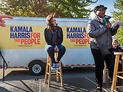 12 OCTOBER 2019 - DES MOINES, IOWA: Senator KAMALA HARRIS (D-CA), left, waits to speak at a Des Moines block party Saturday. Sen. Harris attended a neighborhood block party in Des Moines as a part of her campaign to be the Democratic nominee for the US presidency in 2020. Iowa traditionally holds the first selection of the presidential election cycle. The Iowa caucuses are Feb. 3, 2020.        PHOTO BY JACK KURTZ