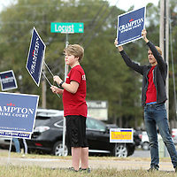 Adam Robison | BUY AT PHOTOS.DJOURNAL.COM<br /> Brayden Stephenson, 14, and Same Robertson, 16, volunteer their time to promote Supreme Court Candidate Steve Crampton at the Precint 7 location at Bissell Baptist Church Tuesday morning in Tupelo.