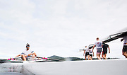 Pascal Lussier stroke seat of the Canadian mens quad that will represent Canada at the Rio Olympic games sits in the boat as members of the under 23 mens eight walk their boat to the water prior to a morning training session on Elk Lake in Victoria, British Columbia on June 22, 2016.