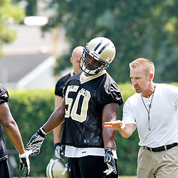 June 6, 2012; Metairie, LA, USA; New Orleans Saints defensive coordinator Steve Spagnuolo with linebacker Curtis Lofton (50) during a minicamp session at the team's practice facility. Mandatory Credit: Derick E. Hingle-US PRESSWIRE