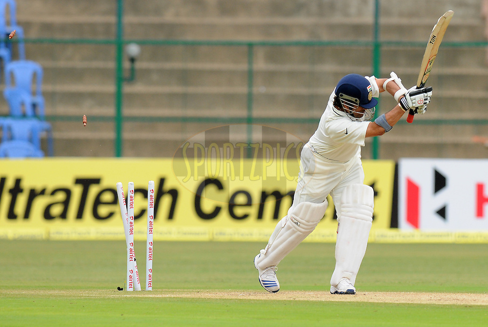 Sachin Tendulkar of India gets bowled out by Doug Bracewell of New Zealand during day two of the second test match between India and New Zealand held at the M. Chinnaswamy Stadium, Bengaluru on the 1st September 2012..Photo by Pal Pillai/BCCI/SPORTZPICS