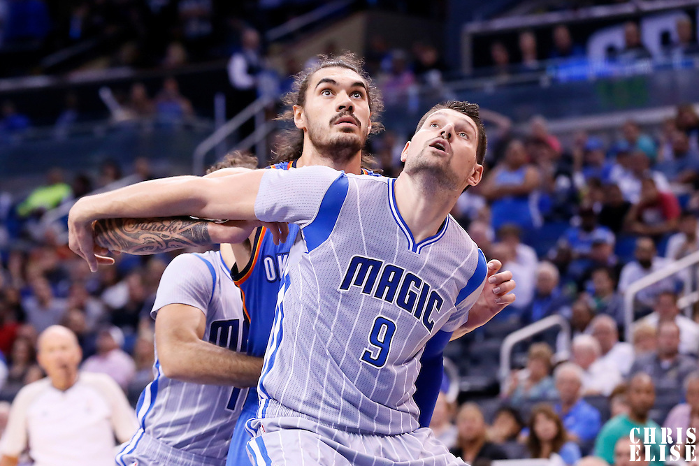 30 October 2015: Orlando Magic center Nikola Vucevic (9) vies for the rebound with Oklahoma City Thunder center Steven Adams (12) during the Oklahoma City Thunder 139-136 double overtime victory over the Orlando Magic, at the Amway Center, in Orlando, Florida, USA.