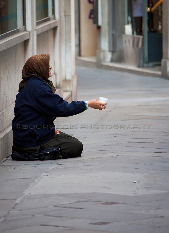 Photo of a woman begging for money in Venice Italy