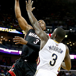 Oct 23, 2013; New Orleans, LA, USA; Miami Heat shooting guard Dwyane Wade (3) shoots over New Orleans Pelicans shooting guard Anthony Morrow (3) during the second half of a preseason game at New Orleans Arena. The Heat defeated the Pelicans 108-95. Mandatory Credit: Derick E. Hingle-USA TODAY Sports