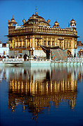 INDIA, RELIGION, SIKHISM Amritsar, the holy city of the Sikhs; the Pool of Nectar reflects the Golden Temple